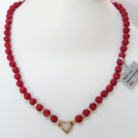 Red Coral Necklace with Sparkling Crystal Features.